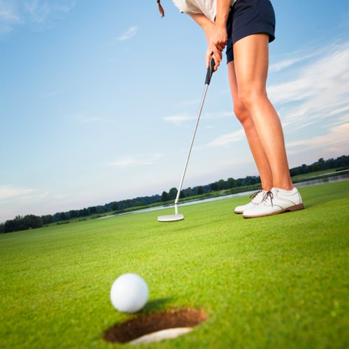 Young woman golfing