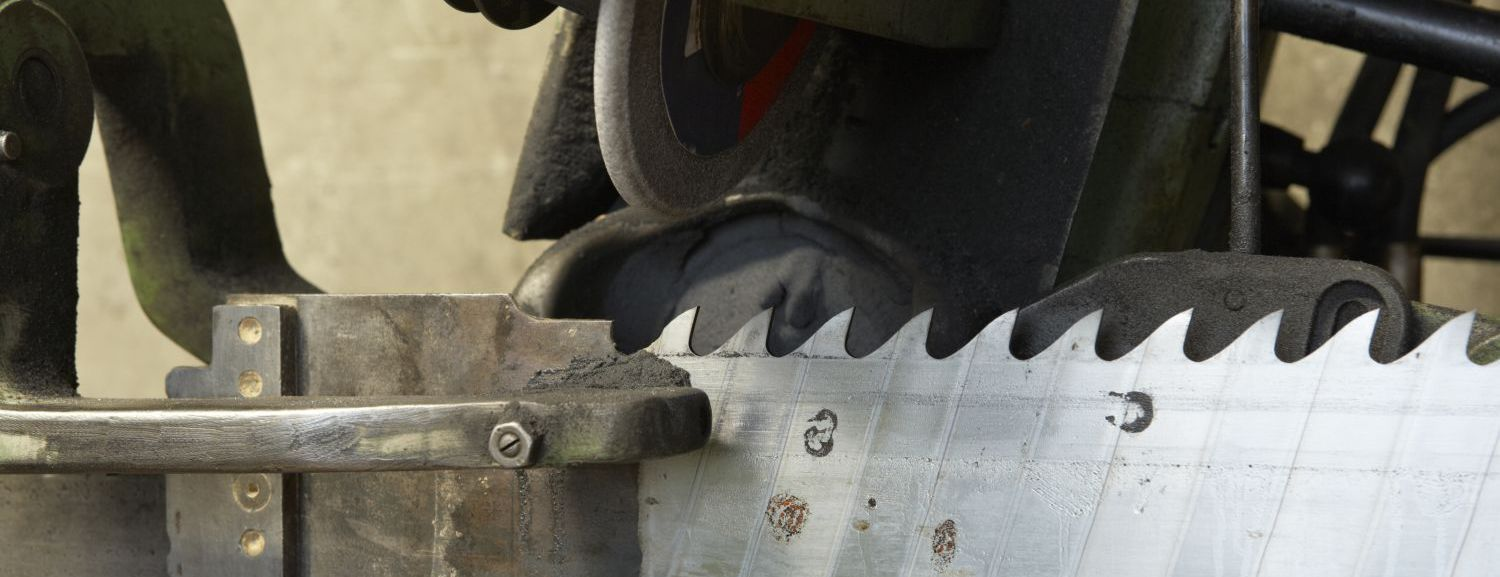 A saw being sharpened as part of sharpening services in the Taranaki Region