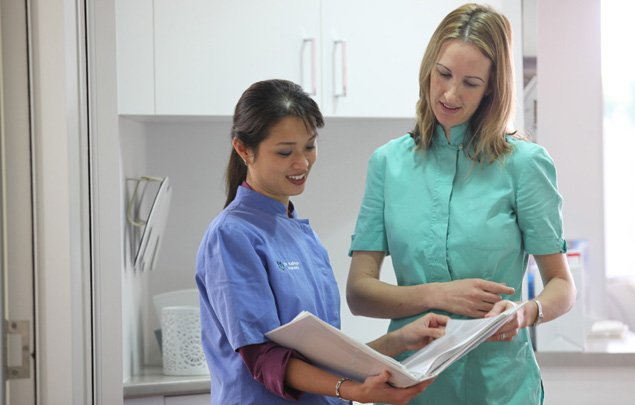 dentists reading a file