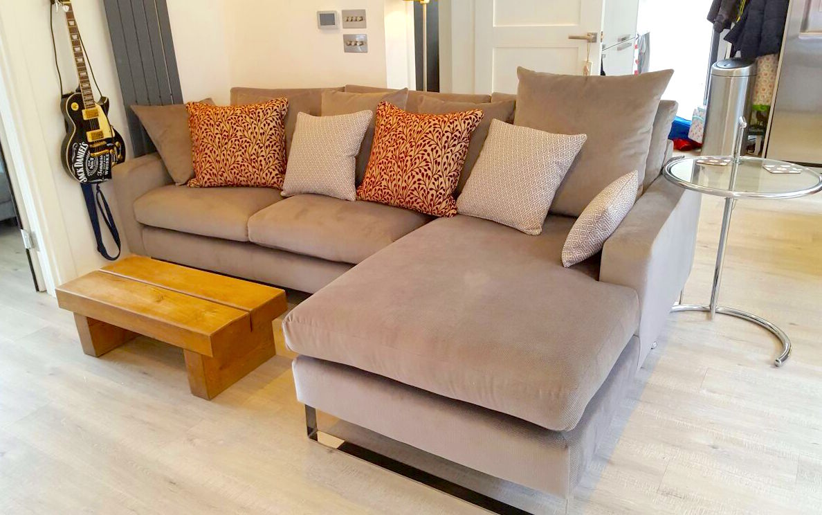 beige coloured sofa