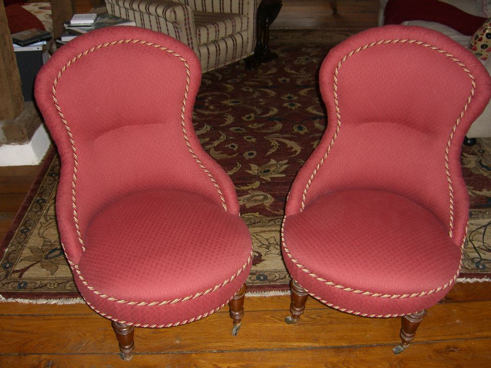 2 chairs with pink fabric
