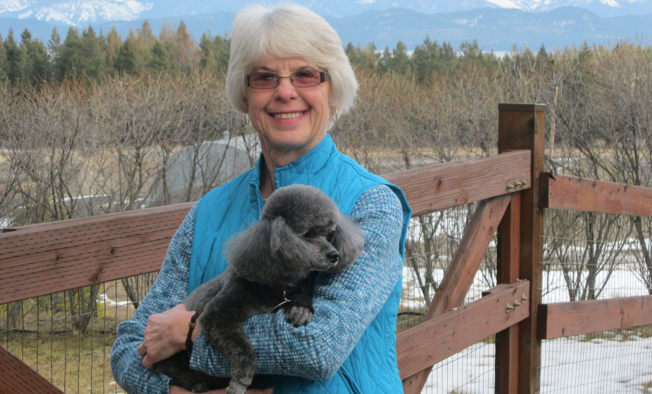 groomed poodle with owner in lakeside mt