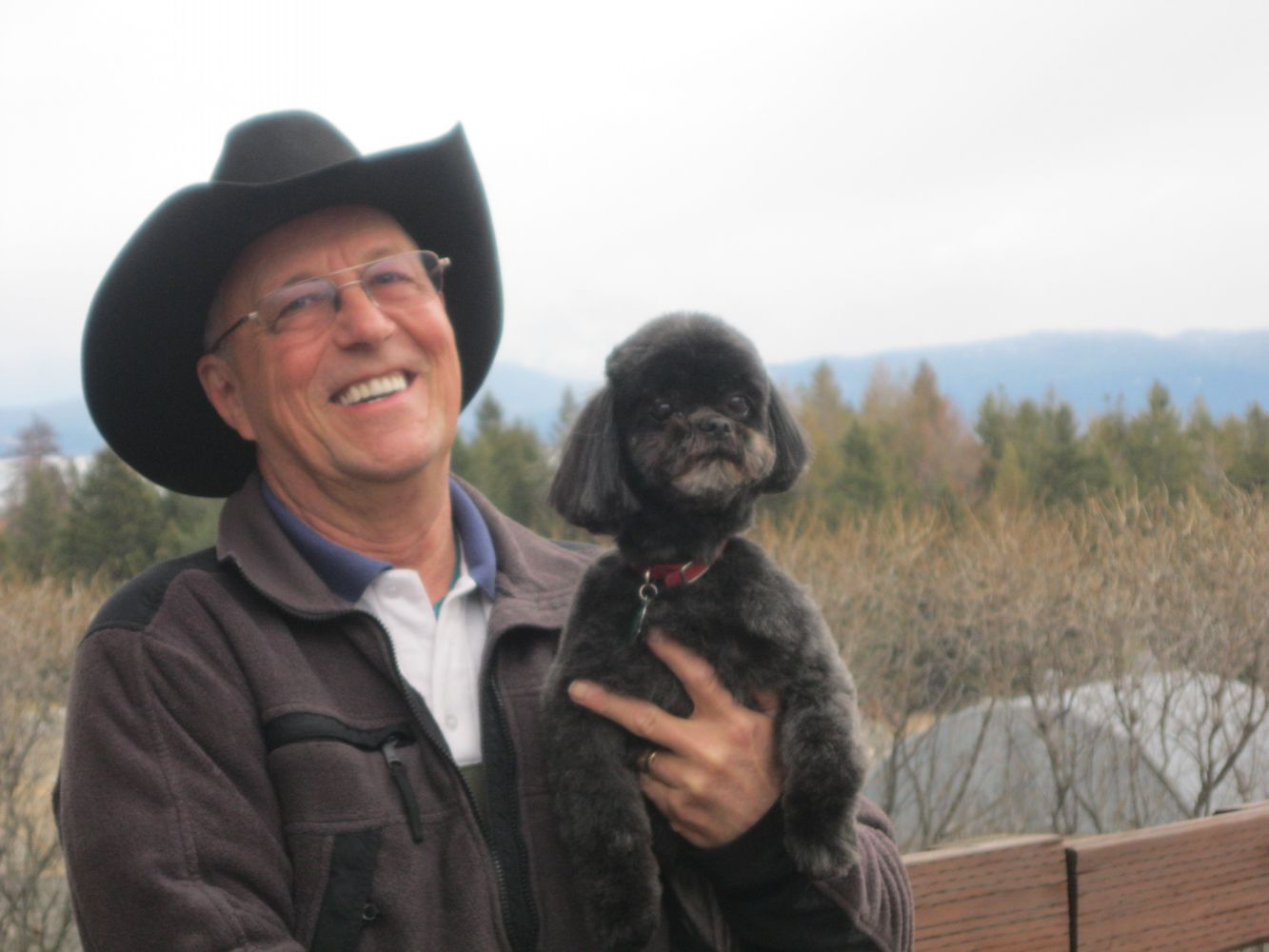 black dog with smiling owner in lakeside mt