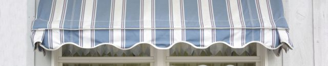 One of our retractable awnings in Auckland with flowers on a windowsill