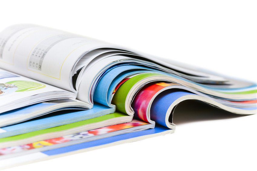 A stack of open magazines