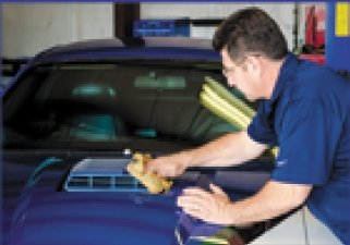 Auto mechanic performing brake repair in San Marcos, TX