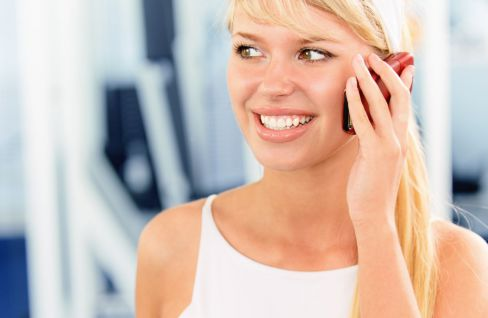 Sporty woman contacts chiropractic services in Thomasville, NC