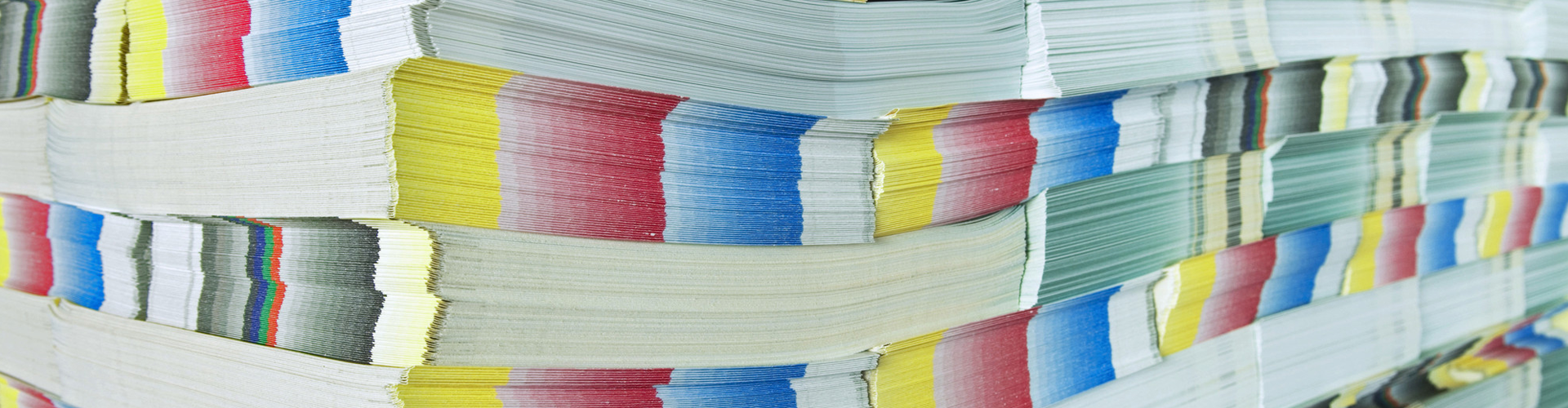 Stacks of white and coloured paper