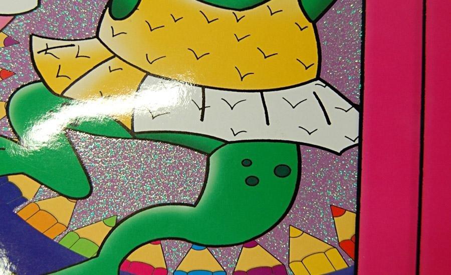 SERIGRAFIA U.V. Carta plastificata lucida con serigrafia con glitter multicolore