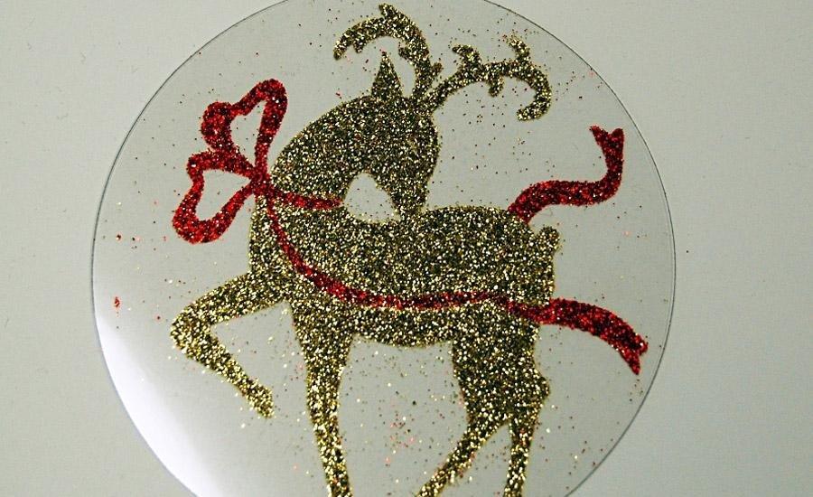 Glitter applicato Applicazione glitter oro e glitter rosso su pvc trasparente e fustellatura