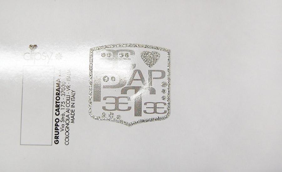 SERIGRAFIA U.V. Carta plastificata lucida con stampa serigrafia glitter argento