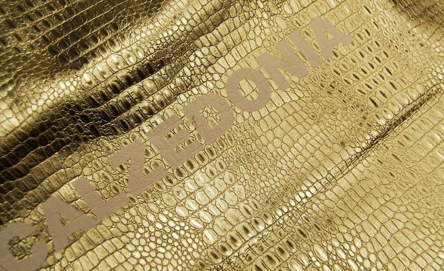 TESSUTISerigrafia monocolore su lamina oro effetto coccodrillo accoppiato al tnt