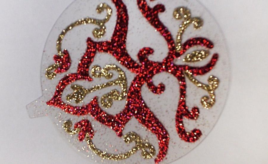 Glitter applicato Applicazione glitter rossi e oro su pvc trasparente