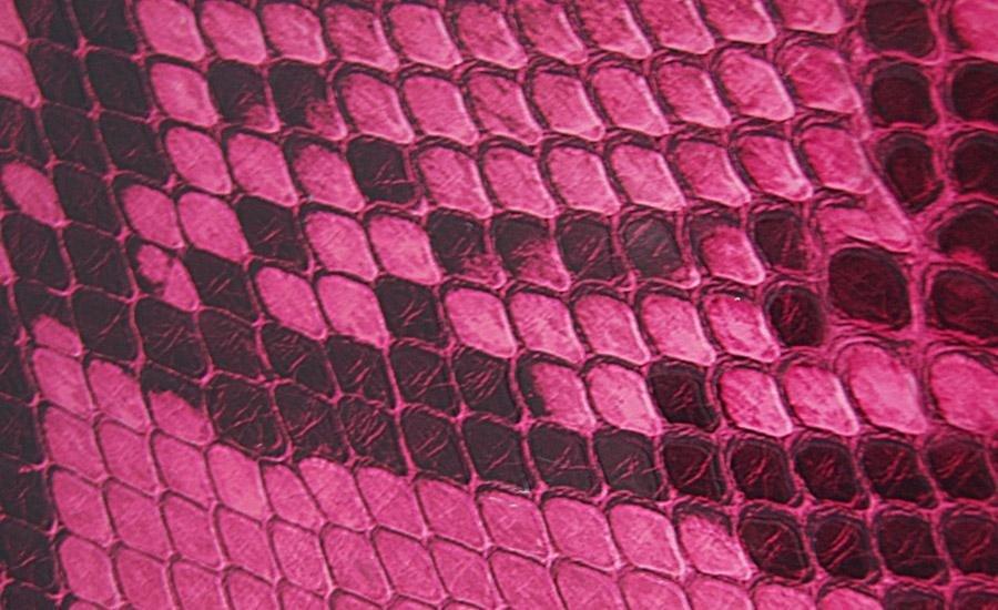 UV LUCIDOOPACO Stampa serigrafica UV lucido con riserva su carta plastificata opaca effetto pitone