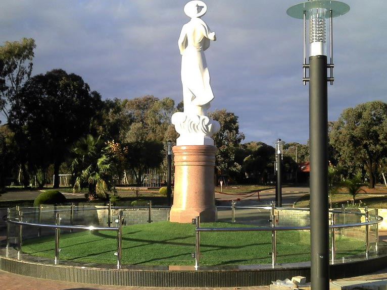 metal rail around statue