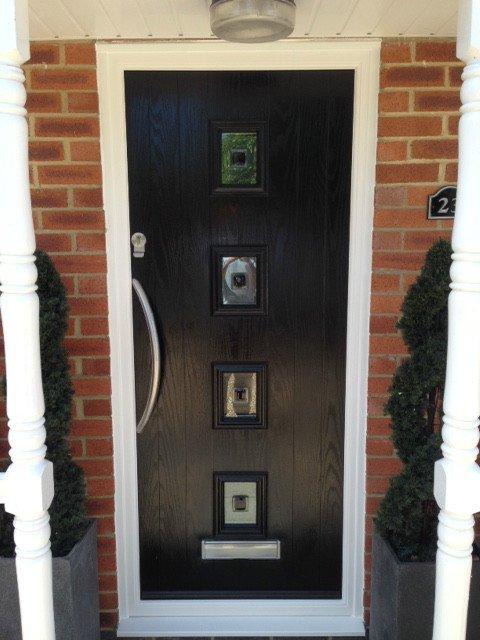 black door with mirrors