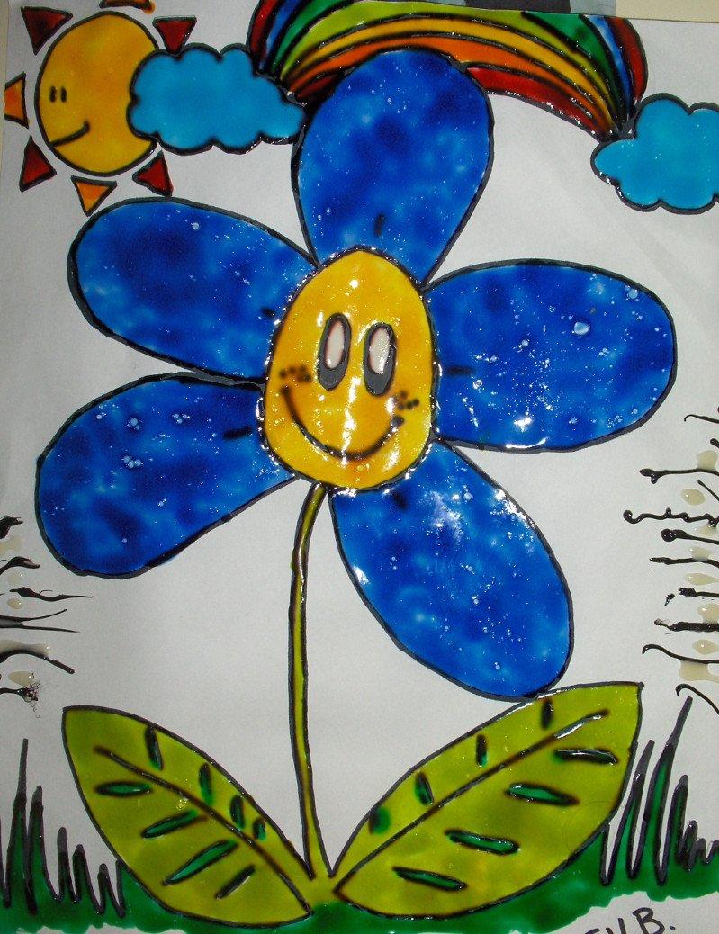 disegno di un fiore azzurro con degli occhi