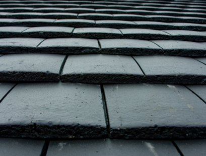close up of grey ceramic roof tiles