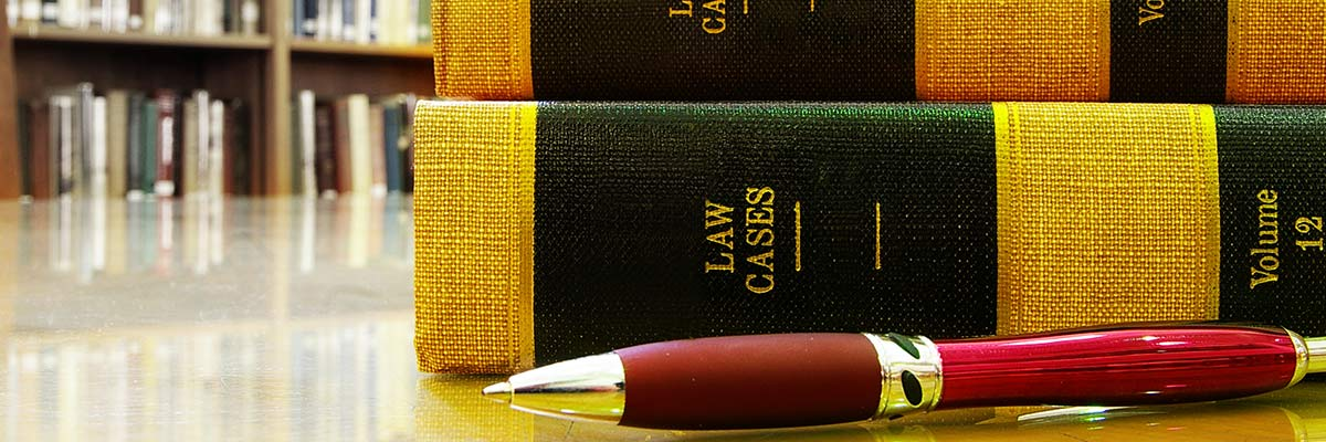 intercept law books pen