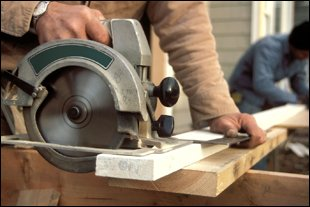 Commercial saw being used by a joiner to cut wooden slats
