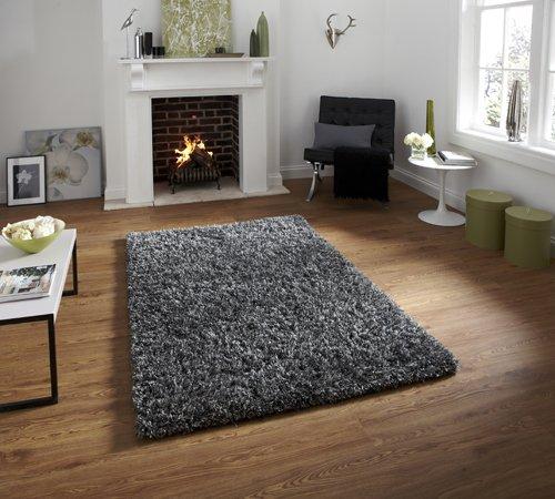 Dark grey color shaggy carpet