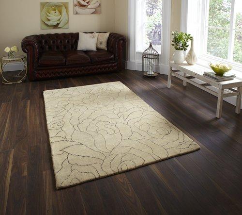 Light color carpet on a dark wooden flooring