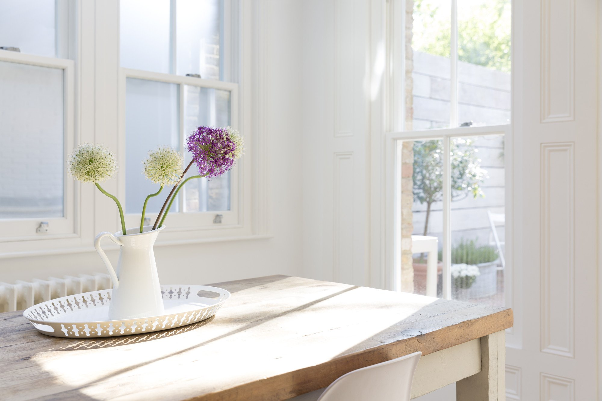 Kitchen with windows, flowers on table