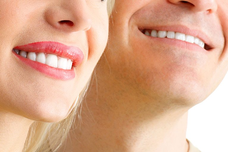 smiling man and woman happy knowing they have the option of sleep dentistry