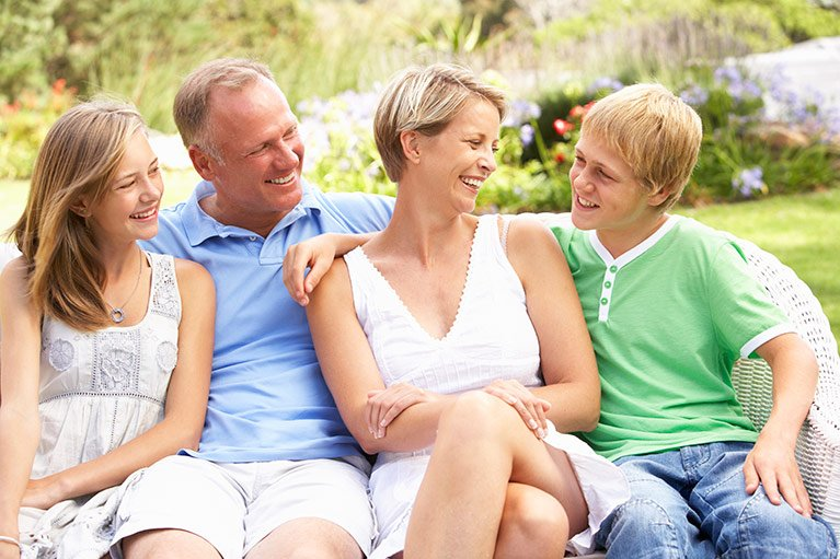 family smiling with a dental plan