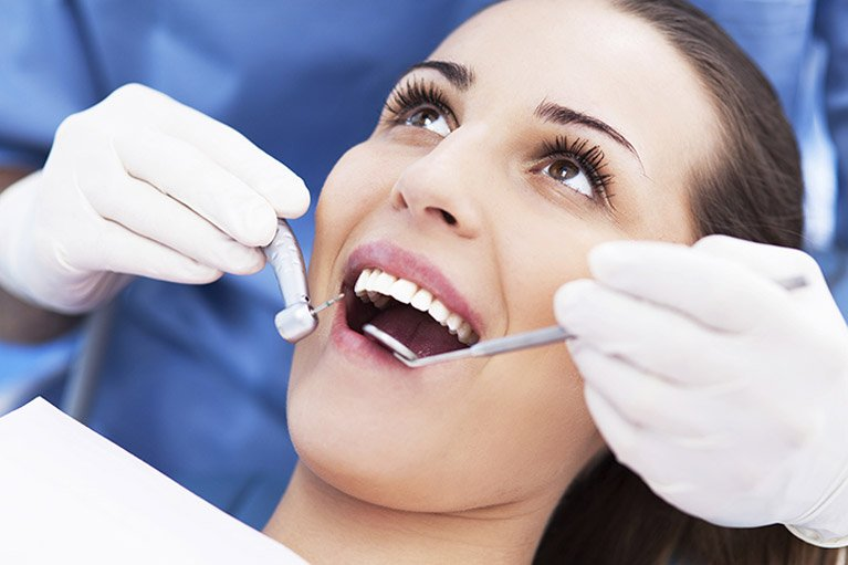 woman getting dental examination