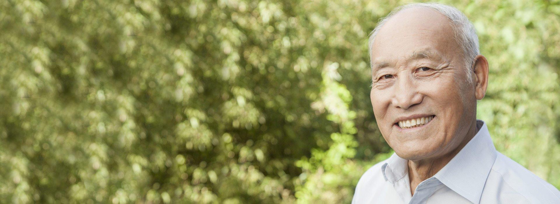 Older Asian man smiling