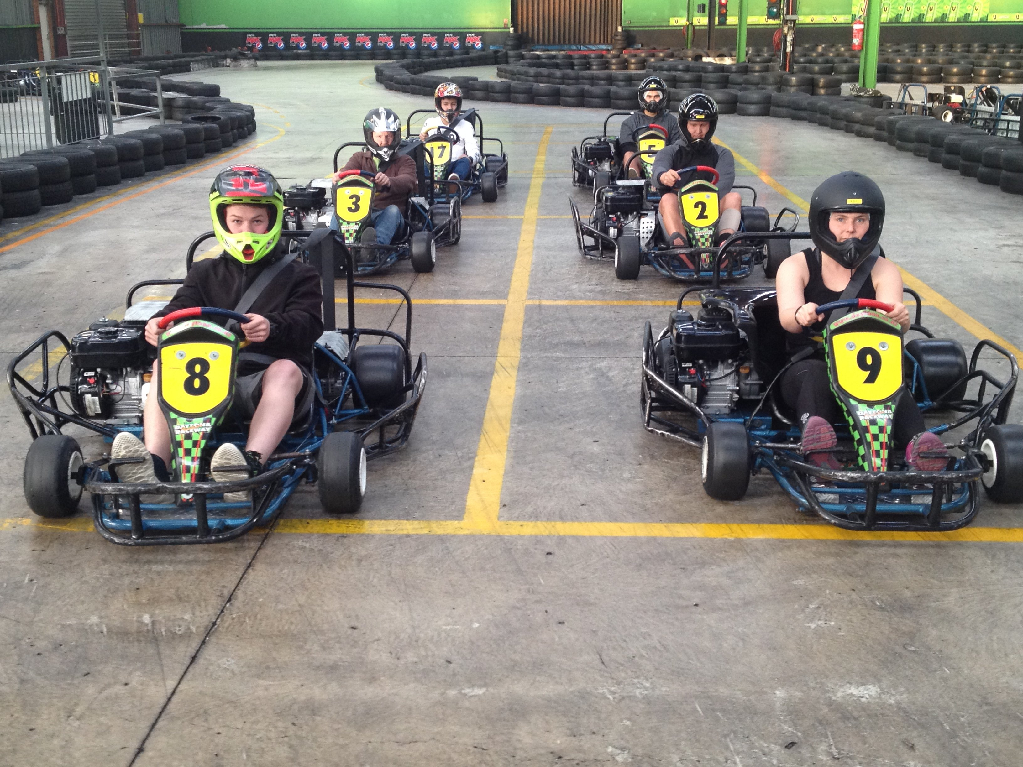 Group of people is driving go kart car