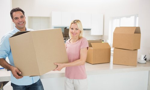 Couple with packed cartons ready for relocation