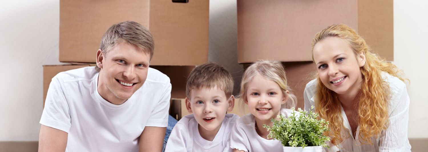 Happy family in their new Hamilton home after help from our removals team
