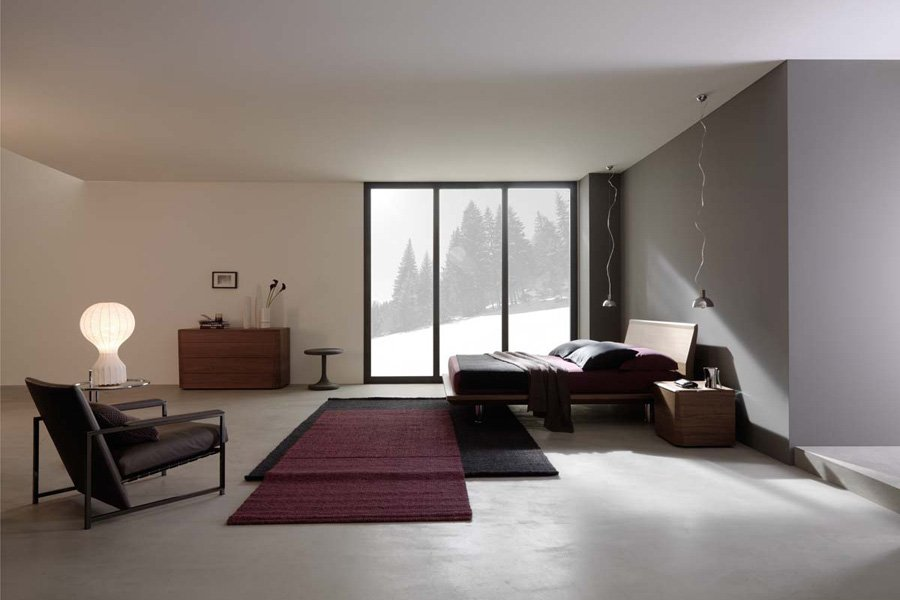 Camera da letto con vista esterna sulle montagne