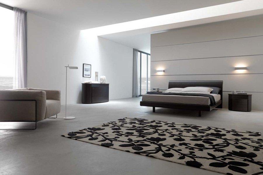 camera da letto moderna con un tappeto