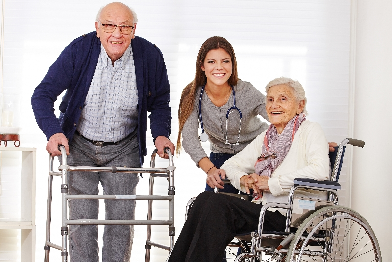 Elderly people with medical equipment at home