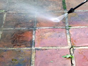Patio being pressure-cleaned