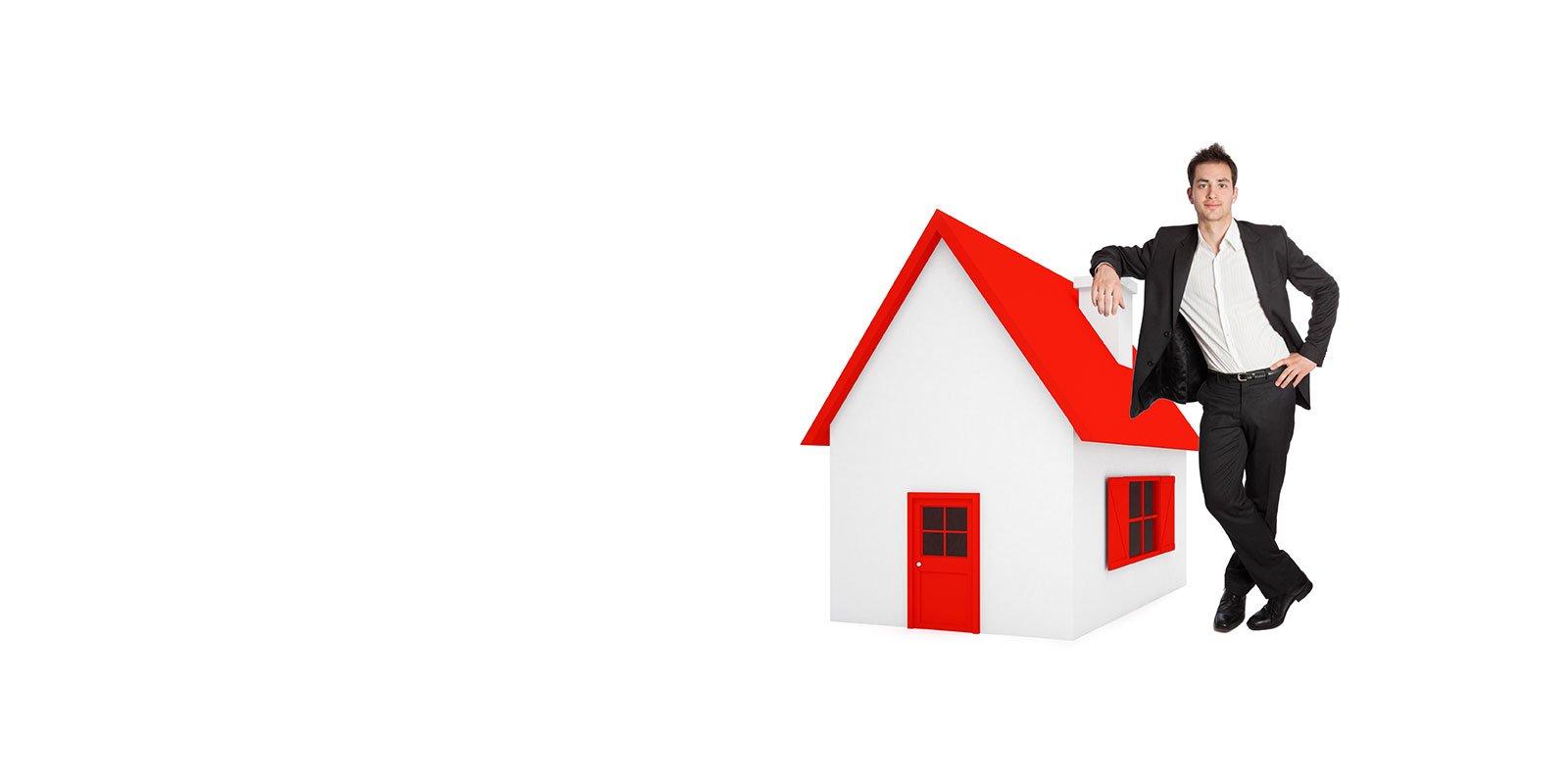 Un modellino di una casa e accanto un uomo in completo nero