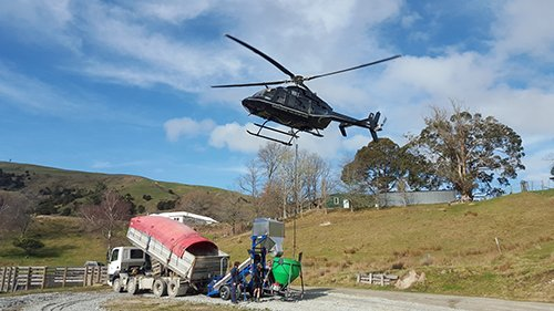 Machine being air lifted with the help of the helicopter