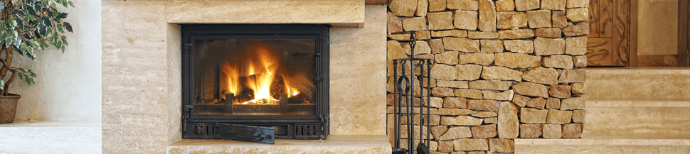 Wood burning in a fireplace in a home