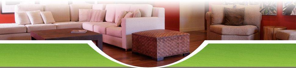 Plush sofas on wood flooring