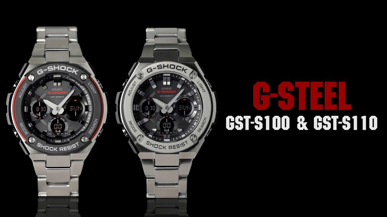 Due orologi metallici su sfondo nero
