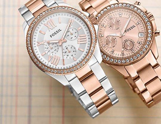 Due orologi con cinturini metallici e quadranti color pastello