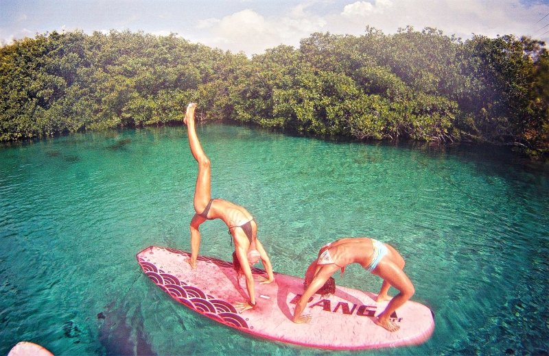 Stand Up Paddleboarding Yoga in Casa Cenote Tulum