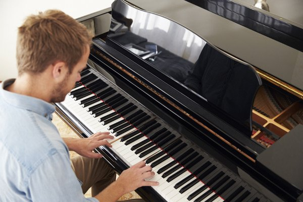 Individual practicing on piano