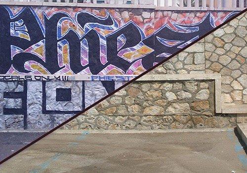 un muro metà con graffiti e metà senza