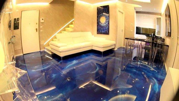 vista interna di una stanza con pavimento in resina luminosi, parete gialla, scala interna e arredamenti di casa