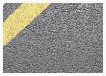 Tarmacadam with yellow stripe