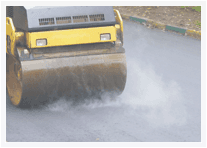 Steam roller on tarmacadam surface